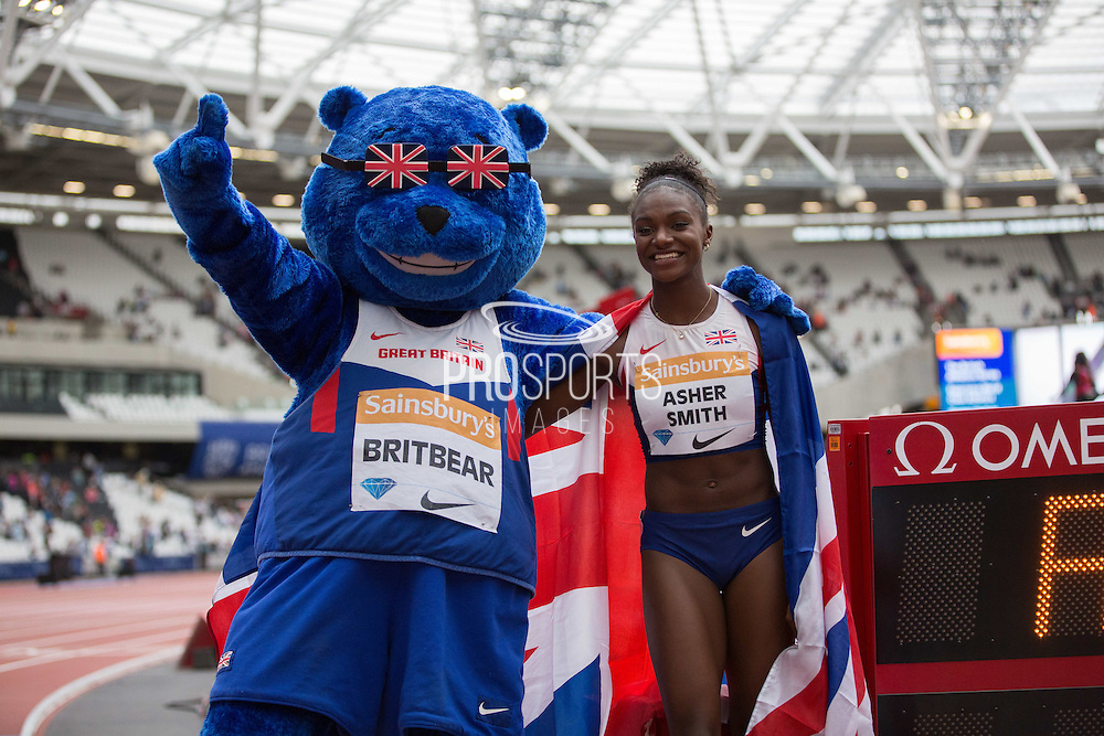 Dina Asher-Smith of Great Britain after the Women's 100m and Britbear Mascot during the Sainsbury's Anniversary Games at the Queen Elizabeth II Olympic Park, London, United Kingdom on 25 July 2015. Photo by Phil Duncan.