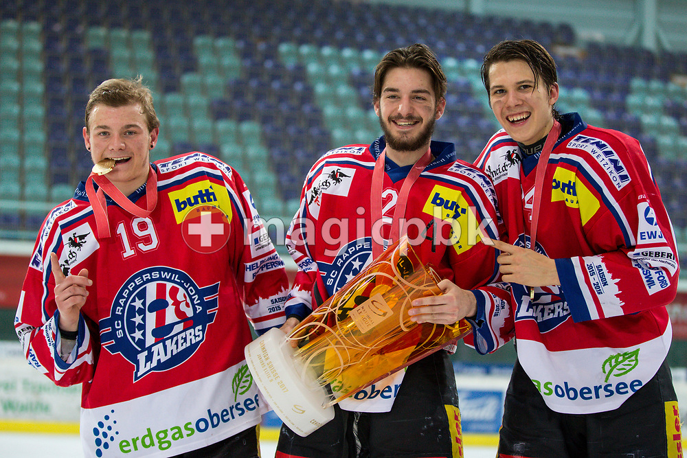 (L-R) Rapperswil-Jona Lakers defenseman Gian Andri Gegenschatz, Joel Brotzge and Lars Mathis pose for a photo with their gold medals and the Swiss Champion trophy after winning the fifth Elite B Playoff Final ice hockey game between Rapperswil-Jona Lakers and ZSC Lions held at the SGKB Arena in Rapperswil, Switzerland, Sunday, Mar. 19, 2017. (Photo by Patrick B. Kraemer / MAGICPBK)