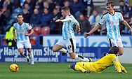 Harry Bunn of Huddersfield Town is tackled by Sol Bamba of Leeds United during the Sky Bet Championship match at the John Smiths Stadium, Huddersfield<br /> Picture by Graham Crowther/Focus Images Ltd +44 7763 140036<br /> 07/11/2015
