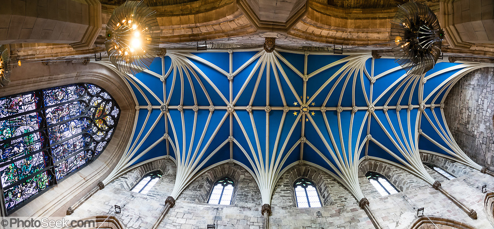"""Vaulted blue ceiling of St Giles' Cathedral (High Kirk of Edinburgh), the principal place of worship of the Church of Scotland in Edinburgh. Its distinctive crown steeple is a prominent feature of the city skyline, at about a third of the way down the Royal Mile. The church has been one of Edinburgh's religious focal points for approximately 900 years. The present church dates from the late 1300s, though it was extensively restored in the 1800s. Today it is sometimes regarded as the """"Mother Church of Presbyterianism."""" The cathedral is dedicated to Saint Giles, who is the patron saint of Edinburgh, as well as of cripples and lepers, and was a very popular saint in the Middle Ages. Edinburgh is the capital city of Scotland, in Lothian on the Firth of Forth's southern shore, Scotland, United Kingdom, Europe. This image was stitched from several overlapping photos."""