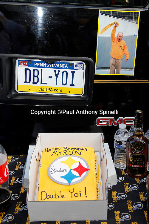 Pittsburgh Steelers fans sport a Happy Birthday Myron Cope birthday cake on the deceased Steelers announcer's birthday occurring on the day of the NFL 2011 AFC Championship playoff football game against the New York Jets on Sunday, January 23, 2011 in Pittsburgh, Pennsylvania. The Steelers won the game 24-19. (©Paul Anthony Spinelli)