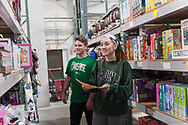 20181204, Tuesday, December 4, 2018, Darmouth, MA, USA &ndash; The My Brother's Keeper Christmas program is expanding in it's 28th season to begin wrapping and delivering from it's brand new Dartmouth location on the South Coast and held it's very first volunteer session Tuesday December 4, 2018. Combined with the My Brother's Keeper facility in Easton the organization is planning to serve over 3,000 families with over 12,000 parents and children for 2018.<br />  <br /> The charity gift giving and wrapping program, in it's 28th year at the Easton facility, is ongoing in &quot;Santa's Workshop&quot; during the Advent season 11 a.m. to 8 p.m. each day. The new Dartmouth facility will be operating on Tuesday, Thursday and Saturday from 11-4 up until December 22.<br /> <br /> ( 2018 &copy; lightchaser photography )