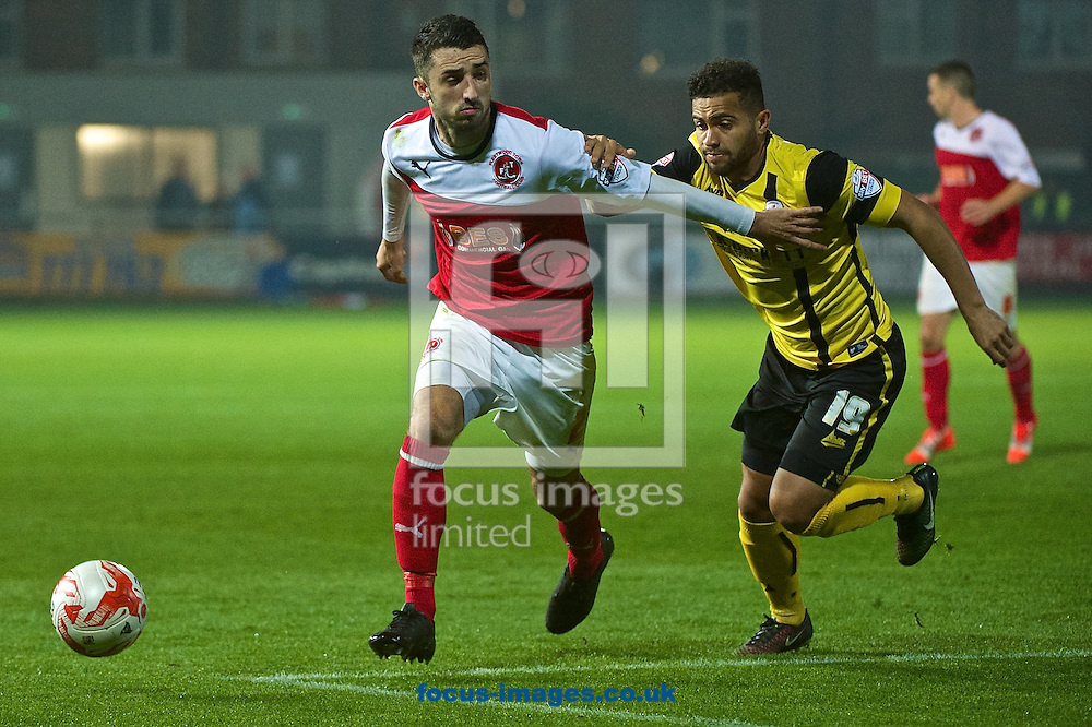 Conor McLaughlin of Fleetwood Town (left) and Reuben Noble-Lazarus of Barnsley during the Sky Bet League 1 match at the Highbury Stadium, Fleetwood<br /> Picture by Ian Wadkins/Focus Images Ltd +44 7877 568959<br /> 17/09/2014