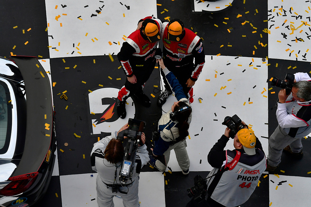 IMSA Continental Tire SportsCar Challenge<br /> BMW Endurance Challenge at Daytona<br /> Daytona Beach, Florida, USA<br /> Friday 26 January 2018<br /> #28 RS1, Porsche Cayman GT4 MR, GS: Dillon Machavern, Spencer Pumpelly in victory lane celebrating the win<br /> World Copyright: Scott R LePage<br /> LAT Images<br /> <br /> ref: Digital Image _SRL1002