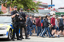 © Licensed to London News Pictures . 27/05/2017 . Manchester , UK . Armed police on Brian Statham Way , outside the stadium ahead of the gig . Manchester music line up , featuring Courteeners , Charlatans , Blossoms and Cabbage , at the Emirates Old Trafford Stadium . Photo credit : Joel Goodman/LNP
