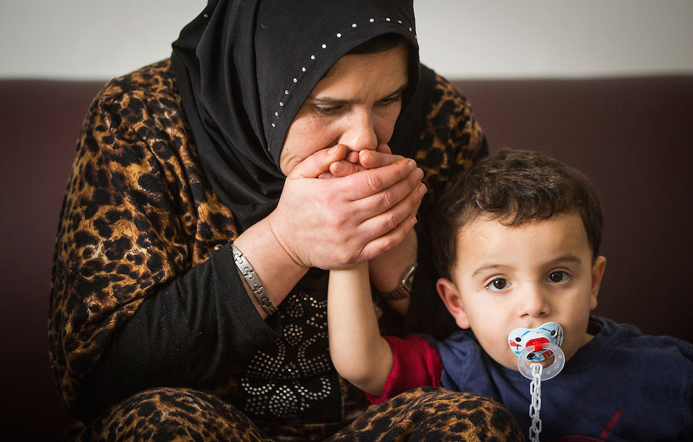 Syrian Refugee Sawsan Al Jasem kisses her son Fadl inside their temporary home in Picton, Ontario, Canada, Wednesday January 20, 2016.   (Mark Blinch for the BBC)