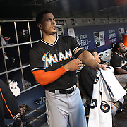 NEW YORK, NEW YORK - July 05: Giancarlo Stanton #27 of the Miami Marlins in the dugout preparing to bat during the Miami Marlins Vs New York Mets regular season MLB game at Citi Field on July 05, 2016 in New York City. (Photo by Tim Clayton/Corbis via Getty Images)