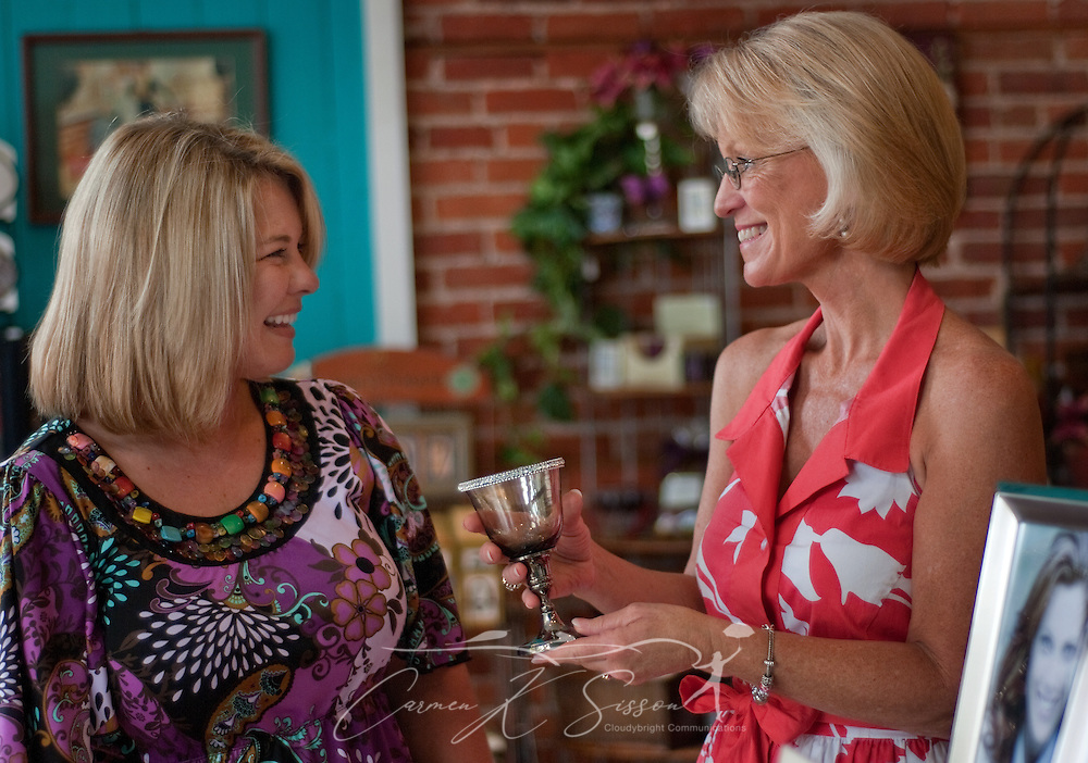 Gloria Herriott (right), owner of Hollyhocks, shows a wedding Communion chalice to Kellie Bishop (left)  Aug. 16, 2010 in Columbus, Miss. (Photo by Carmen K. Sisson/Cloudybright)