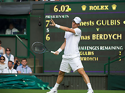 LONDON, ENGLAND - Monday, June 25, 2012: Tomas Berdych (CZE) is hit in the face by the ball during the Gentleman's Singles 1st Round match on the opening day of the Wimbledon Lawn Tennis Championships at the All England Lawn Tennis and Croquet Club. (Pic by David Rawcliffe/Propaganda)