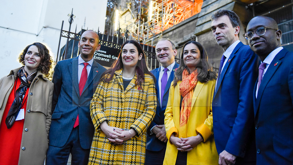 © Licensed to London News Pictures. 30/10/2019. LONDON, UK. <br /> Lib Dem members Luisa Porritt (L), Chukka Umunna (2L), Luciana Berger (3L), Ed Davey (C), Siobhan Benita (3R), Tom Brake (2R) and Sam Gyimah (R) pose for a photo after Jo Swinson, Leader of the Liberal Democrats, addressed the media outside the Houses of Parliament to launch the Lib Dem election campaign ahead of the General Election on 12 December.  Photo credit: Stephen Chung/LNP