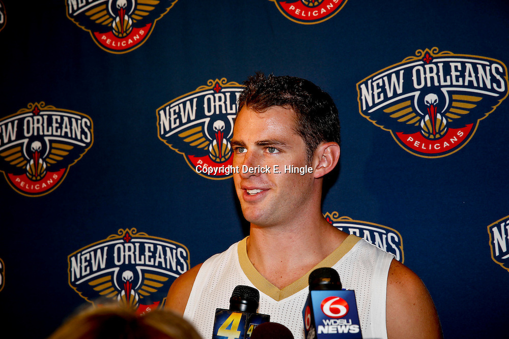 Aug 1, 2013; Metairie, LA, USA; New Orleans Pelicans Jason Smith during a uniform unveiling at the team practice facility. Mandatory Credit: Derick E. Hingle-USA TODAY Sports