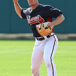 March 16, 2011; Lake Buena Vista, FL, USA; Atlanta Braves second baseman Brooks Conrad (7) before a spring training exhibition game against the Boston Red Sox at the Disney Wide World of Sports complex.  Mandatory Credit: Derick E. Hingle