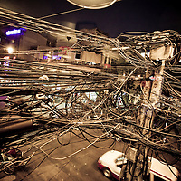 A tangled web of power cables demonstrates the disorganized electrical infrastructure of Saigon Vietnam