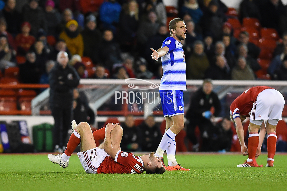 Nottingham Forest forward Ben Brereton (17) in pain after an awkward landing during the EFL Sky Bet Championship match between Nottingham Forest and Reading at the City Ground, Nottingham, England on 20 February 2018. Picture by Jon Hobley.