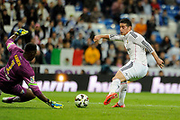 Real Madrid´s James Rodriguez and Malaga´s goalkeeper Idriss Carlos Kameni during 2014-15 La Liga match between Real Madrid and Malaga at Santiago Bernabeu stadium in Madrid, Spain. April 18, 2015. (ALTERPHOTOS/Luis Fernandez)