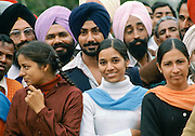 Indian Sikh men in traditional turbans and other students at the university in Delhi, India