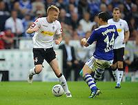FUSSBALL   1. BUNDESLIGA   SAISON 2011/2012    4. SPIELTAG FC Schalke 04 - Borussia Moenchengladbach             28.08.2011 Marco REUS (li, Moenchengladbach) gegen Kyriakos PAPADOPOULOS (re, Schalke)