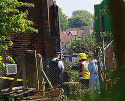 A Fire fighter, a forensic expert and a policeman view the damage caused by a fire, in the Islamic center, Muswell Hill, London. The fire is reported to be from a far right organisation.<br /> United Kingdom<br /> Wednesday, 5th June 2013<br /> Picture by Max Nash / i-Images
