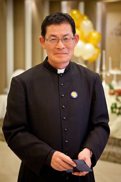 "Portrait of a priest during the so called ""Dol"" (in Korean language) celebration for the first birthday of a child."