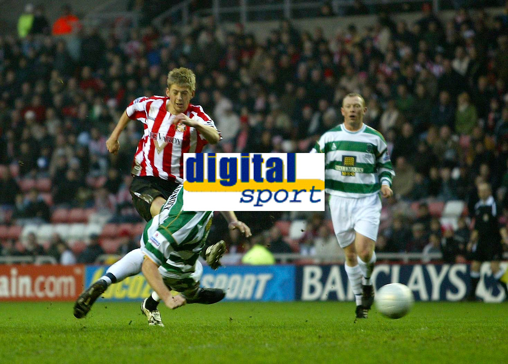 Photo: Andrew Unwin.<br />Sunderland v Northwich Victoria. The FA Cup. 08/01/2006.<br />Northwich's Jon McCarthy (C) tries to block a shot from Sunderland's Jonathan Stead (L).