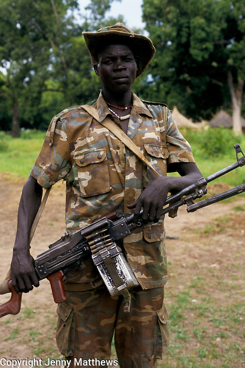 SPLA SOLDIER, WEARING CAMOUFLAGE COMBAT UNIFORM, CARRYING AUTOMATIC WEAPON, SOUTHERN SUDAN, 1997,