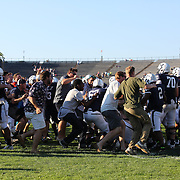 Yale supporterss run onto the pitch and mob their team after the Yale V Army, Football match at Yale Bowl, New Haven. Yale won the match 49-43 in overtime in front of a crowd of 34,142. New Haven, Connecticut, USA. 27th September 2014. Photo Tim Clayton