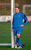 Photo: Glyn Thomas.<br />England Training. 09/11/2005.<br />England's Wayne Rooney watches his teammates train.