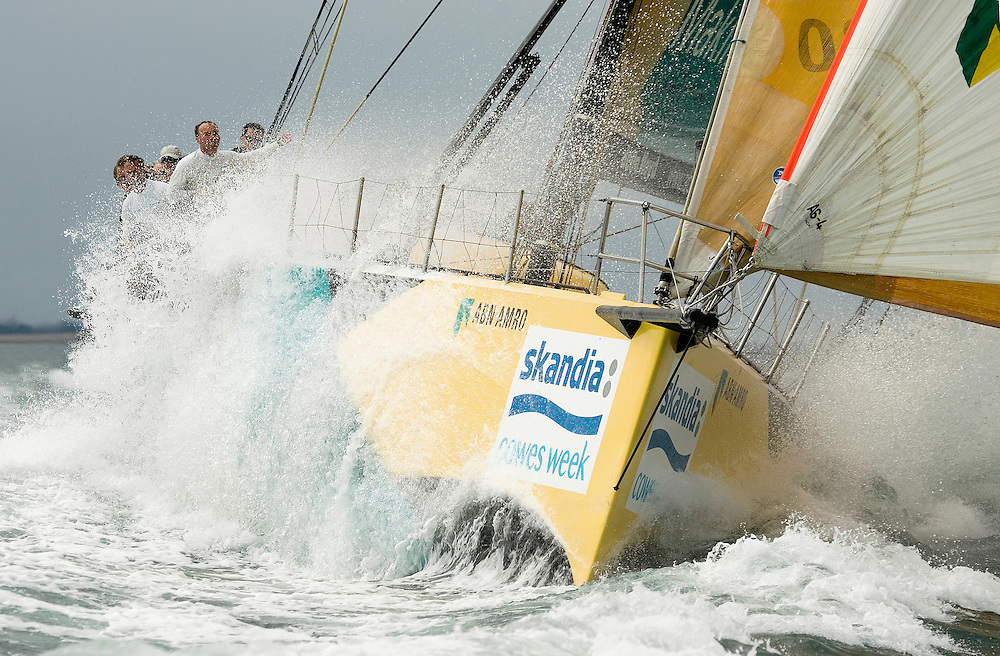 ABN AMRO One, the winner of the 2005-06 Volvo Ocean Race, skippered by Mike Sanderson (NZL), leads the Class 0 fleet, on the first day of Skandia Cowes Week 2006