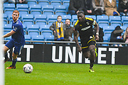 Adedeji Oshilaja of AFC Wimbledon (4) takes on Ryan Sellers of FC Halifax Town (3) during the The FA Cup 2nd round match between FC Halifax Town and AFC Wimbledon at the MBi Shay Stadium, Halifax, United Kingdom on 1 December 2018.