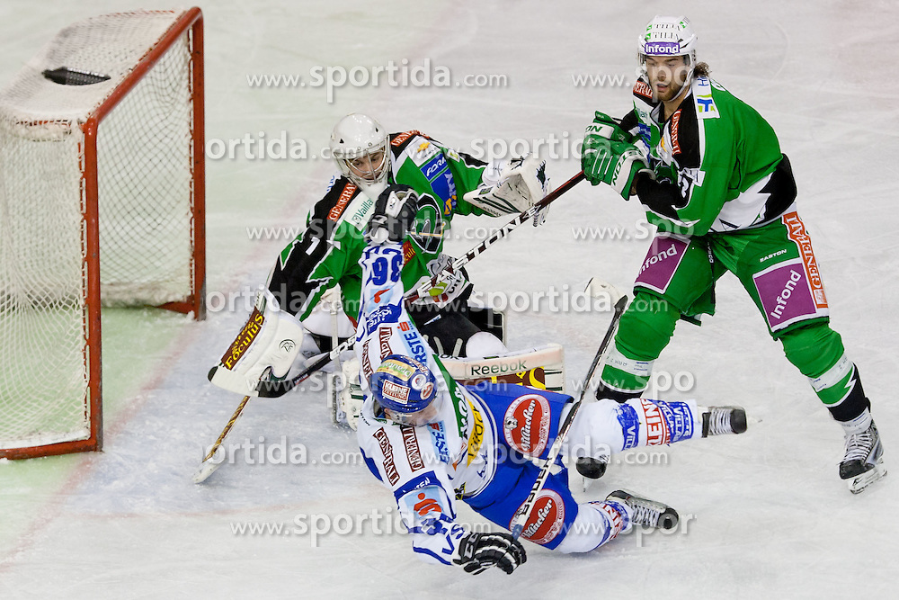 Marco Pewal (EC Rekord Fenster VSV, #36) vs Jean-Philippe Lamoureux (HDD Tilia Olimpija, #1) and Brad Cole (HDD Tilia Olimpija, #2) during ice-hockey match between HDD Tilia Olimpija and EC Rekord Fenster VSV in 38th Round of EBEL league, on Januar 6, 2012 at Hala Tivoli, Ljubljana, Slovenia. (Photo By Matic Klansek Velej / Sportida)