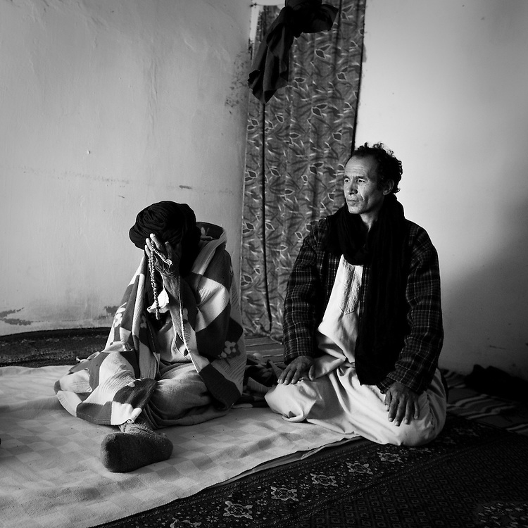 Nazih Kmah, left, victim of land mines in 1983, in Smara refugee camp, and his son Sidi Brahim Nazih, right, victim of land mines in 1981, in Aras Gafra village, are seen in their room at Land Mines Victim Center Martyr El Scherif in refugee camp of Rabuni, Tuesday, March 1, 2011. After Spanish colonizers left Western Sahara in 1975, Morocco and Mauritania went to war over it. By 1979, Mauritania had pulled out and Morocco had taken over. But fighting continued between 15,000 Saharaui's Polisario guerrillas and Morocco's U.S. equipped army. A U.N. negotiated truce in 1991 called for a referendum on the region's future, but that vote never happened.