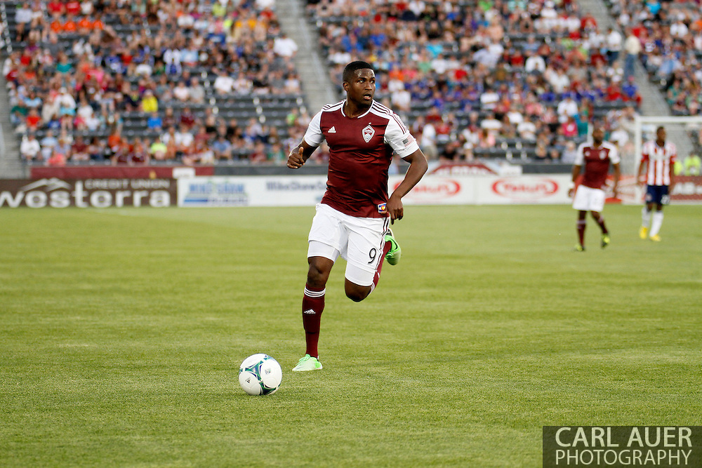 May 25th, 2013 Commerce City, CO - Colorado Rapids forward Edson Buddle (9) chases down the ball in the first half of the MLS match between Chivas USA and the Colorado Rapids at Dick's Sporting Goods Park in Commerce City, CO