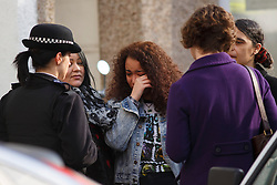 © licensed to London News Pictures. London, UK 01/03/2014. Mourners visiting where two men, believed to be in their 20s, were found injured in a vehicle and later died in Leytonstone, east London on Saturday, 1 March 2014. Photo credit: Tolga Akmen/LNP