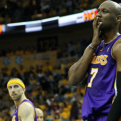 April 22, 2011; New Orleans, LA, USA; Los Angeles Lakers power forward Lamar Odom (7) reacts during the second quarter in game three of the first round of the 2011 NBA playoffs against the New Orleans Hornets at the New Orleans Arena.    Mandatory Credit: Derick E. Hingle