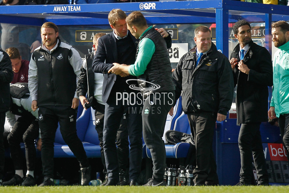 Swansea City Manager Graham Potter congratulates Queens Park Rangers Caretaker Manager John Eustace after the final is whistle is block in the EFL Sky Bet Championship match between Queens Park Rangers and Swansea City at the Loftus Road Stadium, London, England on 13 April 2019.
