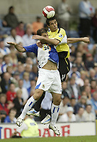 Photo: Aidan Ellis.<br /> Blackburn Rovers v Manchester City. The Barclays Premiership. 17/09/2006.<br /> City's Bernardo Corrardi out jumps Rovers Zurab Khizanishvili
