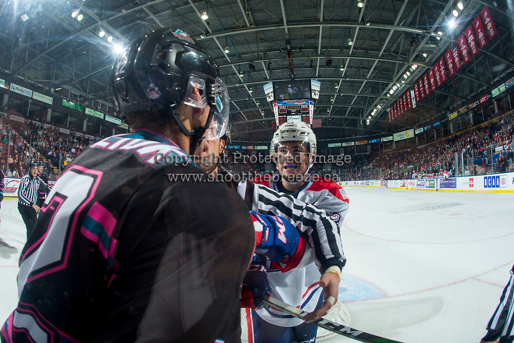 KELOWNA, BC - SEPTEMBER 21:  Linesman Dustin Minty gets between Dillon Hamaliuk #22 of the Kelowna Rockets and Bobby Russell #21 of the Spokane Chiefs during third period at Prospera Place on September 21, 2019 in Kelowna, Canada. (Photo by Marissa Baecker/Shoot the Breeze)