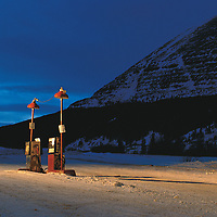 Canada, British Columbia, Deserted gas pumps at dusk at Summit Lodge along Alaska Highway.