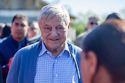Mr. George Soros visiting the Roma part of the village Frumusani in Romania and talking to local inhabitants.
