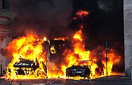 Roma 14 Dicembre 2010.Manifestazione contro il Governo Berlusconi.. Un blindato della Guardia di Finanza e un automobile incendiati dai manifestanti in via del Babbuino.