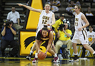 February 18, 2010: Minnesota forward/center Ashley Ellis-Milan (21) grabs a lose ball as Iowa center Morgan Johnson (12) and Iowa forward Kelly Krei (20) look on during the second half of the NCAA women's basketball game at Carver-Hawkeye Arena in Iowa City, Iowa on February 18, 2010. Iowa defeated Minnesota 75-54.