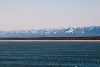 Russia, Sakhalin, Sea of Okhotsk. Sakhalin coastline with snow covered mountains.