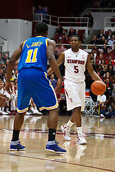 Dec 29, 2011; Stanford CA, USA;  Stanford Cardinal guard Chasson Randle (5) is defended by UCLA Bruins guard Lazeric Jones (11) during the first half at Maples Pavilion.  Stanford defeated UCLA 60-59. Mandatory Credit: Jason O. Watson-US PRESSWIRE