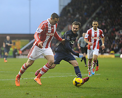 Manchester United's Juan Mata battle for the ball with Stoke City's Geoff Cameron - Photo mandatory by-line: Alex James/JMP - Tel: Mobile: 07966 386802 01/02/2014 - SPORT - FOOTBALL - Britannia Stadium - Stoke-On-Trent - Stoke v Manchester United - Barclays Premier League