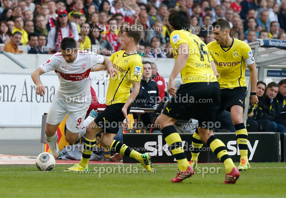 29.03.2014, Mercedes Benz Arena, Stuttgart, GER, 1. FBL, VfB Stuttgart vs Borussia Dortmund, 28. Runde, im Bild Vedad Ibisevic (VfB Stuttgart), Erik Durm (Borussia Dortmund) // during the German Bundesliga 28th round match between VfB Stuttgart and Borussia Dortmund at the Mercedes Benz Arena in Stuttgart, Germany on 2014/03/29. EXPA Pictures &copy; 2014, PhotoCredit: EXPA/ Eibner-Pressefoto/ BW-Foto<br /> <br /> *****ATTENTION - OUT of GER*****