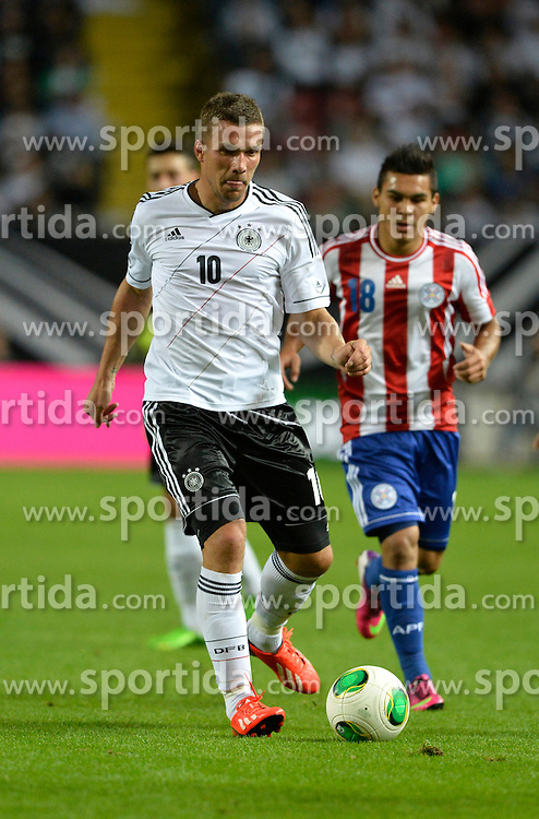 14.08.2013, Fritz Walter Stadion, Kaiserslautern, GER, Testspiel, Deutschland vs Paraguay, im Bild Lukas Podolski (GER) am Ball Aktion hoch Hochformat // during the international friendly match between Germany and Paraguay at Fritz Walter Stadium, Kaiserslautern, Germany on 2013/08/14. EXPA Pictures &copy; 2013, PhotoCredit: EXPA/ Eibner/ Michael Weber<br /> <br /> ***** ATTENTION - OUT OF GER *****