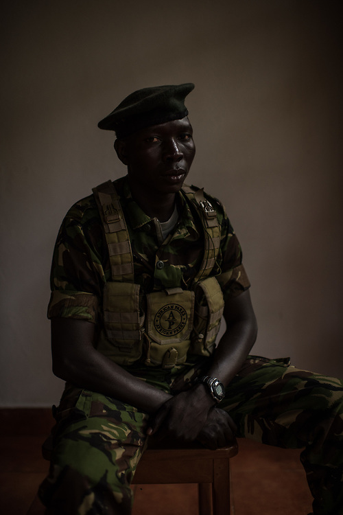 "John Agele Adriko, 33, from Aru Province, sits for a portrait at Garamba National Park on November 25, 2017. Adriko  has been a ranger for 11 years in Garamba National Park, a park embattled with numerous threats to its wildlife. <br /> <br /> ""There are some people when they see a snake they're are scared ant their reaction is to flee. There are other people who when they see a snake they are not scared and move closer to see what kind of snake it is."""