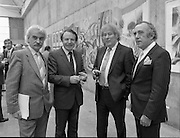 The G.P.A.awards for Emerging Artists..(Guinness Peat Aviation).1984..23.09.1984..09.23.1984..23rd September 1984..The award ceremony was held at The Royal Hibernian Academy of Arts,Gallagher Gallery,Ely Place,Dublin..Image of Mr Noel Sheridan,Chairman of the Advisory Panel,Mr Ted Nealon TD,Minister for Arts and Culture,Mr Tony Ryan,Director GPA,as they congratulate Mr Seamus Heaney,winner of the GPA award for Outstanding Individual Contribution to the Arts.