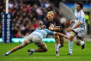 London - Saturday, November 14th 2009: Shane Geraghty of England is tackled by Patricio Albacete of Argentina during the Investec Challenge Series Game at Twickenham, London. ..(Pic by Alex Broadway/Focus Images)