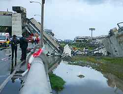 August 14, 2018 - Genoa, Italy - A highway bridge has partially collapsed near Genoa Italy. At least 25 people have died in the collapse of a major motorway bridge in the northwest Italian city of Genoa on Tuesday. (Credit Image: © Arata/Fotogramma/Ropi via ZUMA Press)